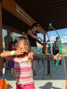 Angela does archery. Just look at that perfect release.