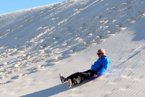 Sledging in White Sands National Monument.