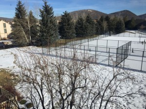 View from 2nd bedroom over the tennis courts, with mountains in the background.