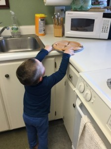 Having made his pizza he disappears into the kitchen to put it into microwave. Smart cookie.