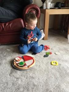 Jasper makes his toy pizza.