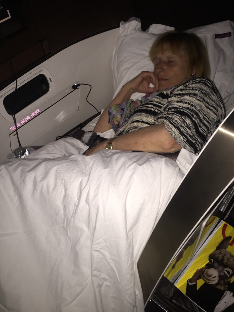 On the flight home in 2015 here's my carer asleep on the job!