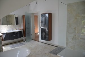 Bathroom with walk in shower big enough for a football team.