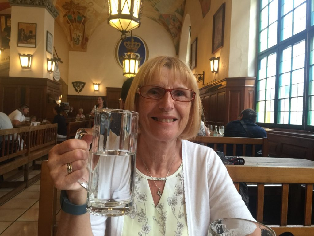 Wendy drinking in the Hofbrau Haus. Well someone has to drive.